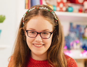 Keira, a smiling girl wearing glasses with long hair