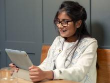 Smiling girl with her iPad