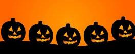 Orange background with silhouette of 5 pumpkins with scary faces
