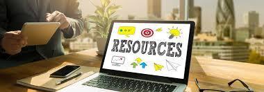 'Resources' written as text on an open laptop screen on a desk