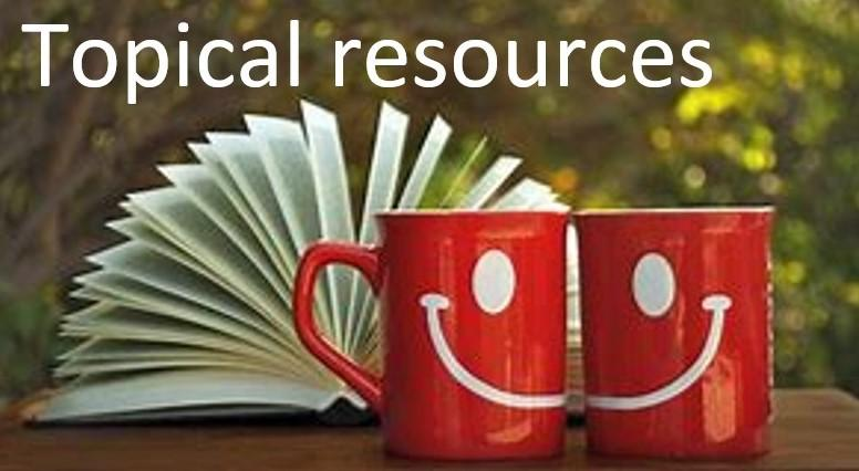 'Topical resources' and open book with 2 mugs with a smiley face printed across them