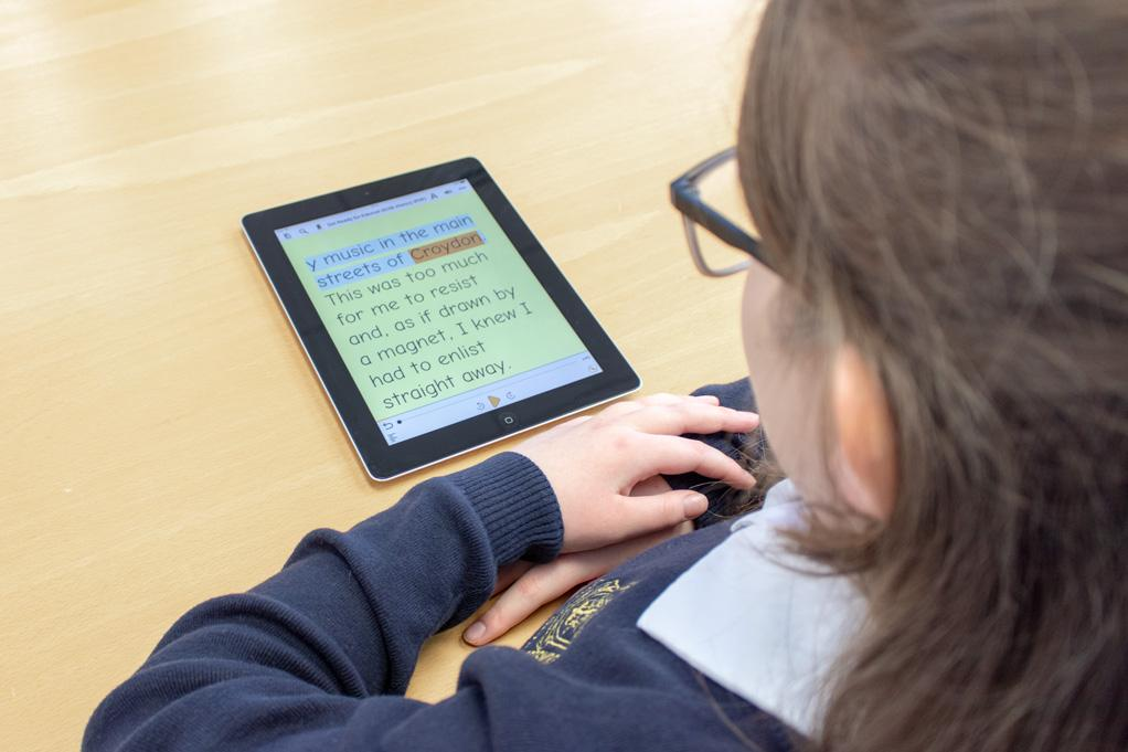 school learner looking at an iPad viewing text via Dolphin Easyreader
