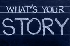 Blackboard with chalk writing 'Whats your story?'